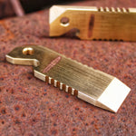 Mini pocket prybar in brass, beer bottle opener, keyring, prybar, flat headed screws driler, phillips screw driver, pryer, mini crowbar, sating finish, jimping on the sides. Made by Hand by Mikkel Hvedegaard, Hvedegaard Knives