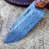 Custommade hunting knife in Damasteel vinland pattern, this is the JGT II hunting knife model, handmade custom knife, made to fit customers requests. Made in Denmark, made by hand, by Mikkel Hvedegaard