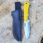 Handmade bushcraft knife, yellow canvas micarta, stainless steel rwl34, black leather sheath with yellow stiching. Made in denmark by young knife maker Mikkel Hvedegaard