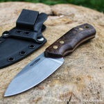 Hunting knife model JGT II, by Hvedegaard Knives. blade in rwl34 stainless steel, handle consists of walnut burl, red liners and brass pins. Here seen with a black kydex sheath. thing hunting knife is made in Denmark by Mikkel Hvedegaard a 23 year old knifemaker