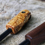 Birch burl ferro rod aka firesteel, get a firesteel that feels great in hand, so you wont drop it in wet conditions. Is beautiful to look at. And sparks everytime you strike it. Made in hand for you hand by Hvedegaard Knives in Denmark