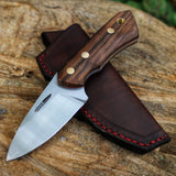 Turkish Walnut handle on the smaller hunting knife model, the Huntee by Hvedegaard Knives. Perfect for skinning game, with its compact design. Comes with a nice leather sheath to match. Steel is rwl34 hardened to 60 hrc, for great edge retention.