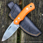 Orange g10 handle on a JGT II hunting knife model, by Hvedegaard Knives in Denmark. This handmade hunting knife is made in rwl34 stainless steel heat treated to 60 hrc. The orange g10 makes this knife ideal for field use, as you can find it easily if you put it down on the ground. The knis comes with a nice handmade leather sheath dyed black with orange stitching.