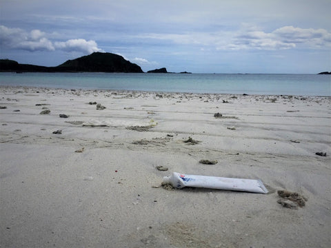 Plastic toothbrush tube washed up on the shore of Lombok island, Indonesia