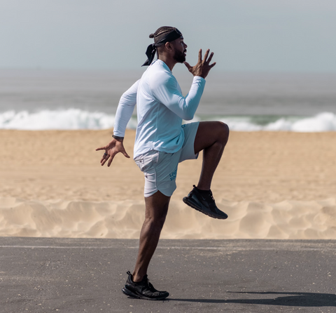 FightCamp Trainer Coach PJ Doing A-Skip Exercises on the Beach