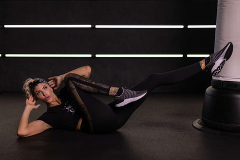 Shanie Smash Cooling Down With Bicycle Crunches