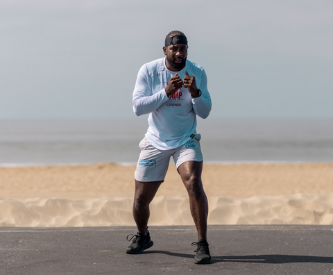 FightCamp Trainer Coach PJ Doing a Bob and Weave Boxing Drill on the Beach