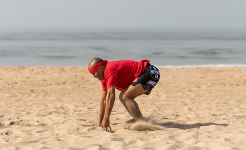 FightCamp Trainer Flo Master Doing Burpees On The Beach