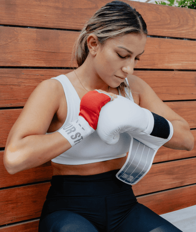 Female Putting On FightCamp Boxing Gloves
