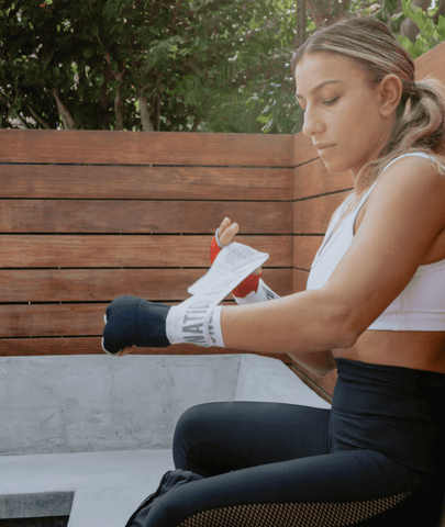 Female Putting On FightCamp Boxing Hand Wraps
