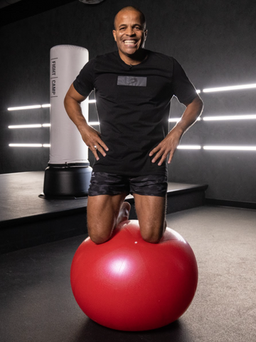 Flo Master Doing a Knee Balance Exercise on a Fitness Ball