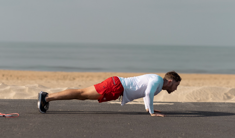 FightCamp Co-Founder and Trainer Tommy Duquette Doing Push-Ups On The Beach