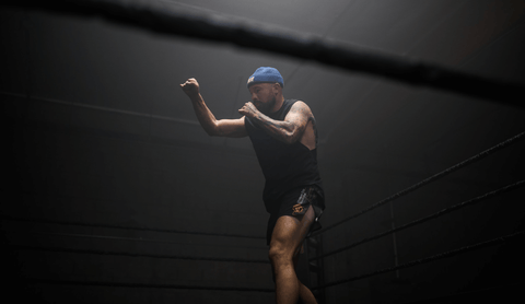 FightCamp Trainer Aaron Swenson Shadowboxing in a Boxing Ring
