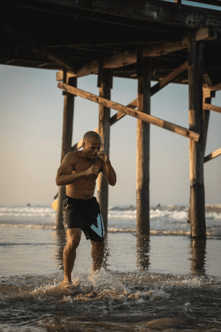 FightCamp Trainer Flo Master Shadowboxing on the Beach for an Early Morning Workout