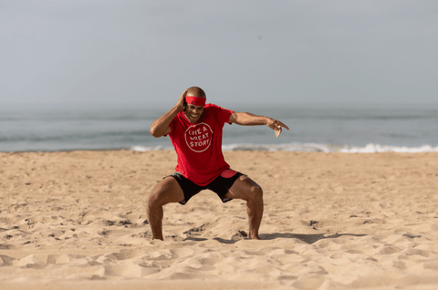 FightCamp Trainer Flo Master Doing Squat Grooves on the Beach