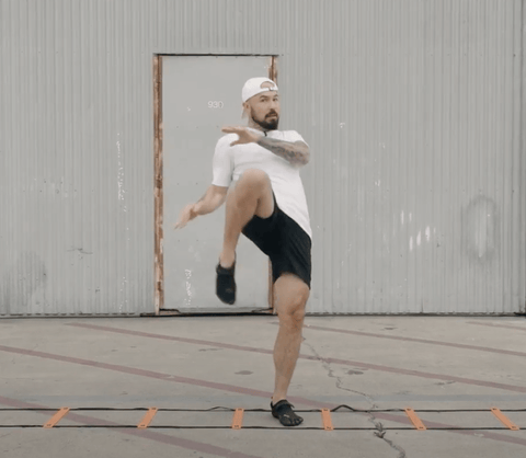 Aaron Swenson Doing a Step In Knee Agility Ladder Drill