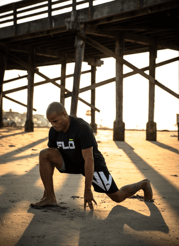 FightCamp Trainer Flo Master Stretching on the Beach for an Early Morning Workout