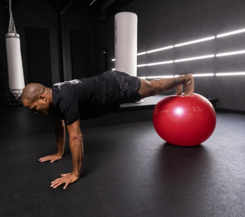 Flo Master Doing a Walk Out Exercise on a Fitness Ball
