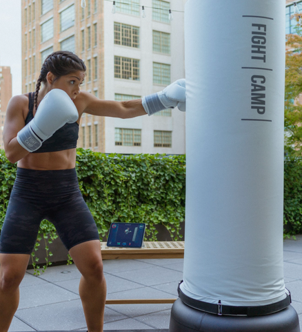 Boxer throwing punches on a punching bag