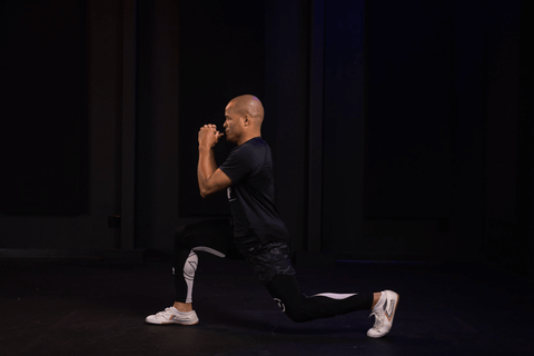 FightCamp Trainer Flo Master Doing Lunges