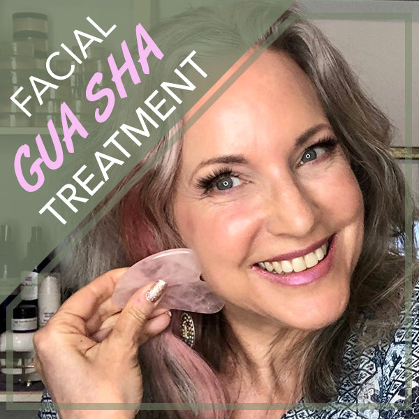 lisa with gua sha beauty tool