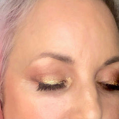 close up of lisa's eyes with golden glam