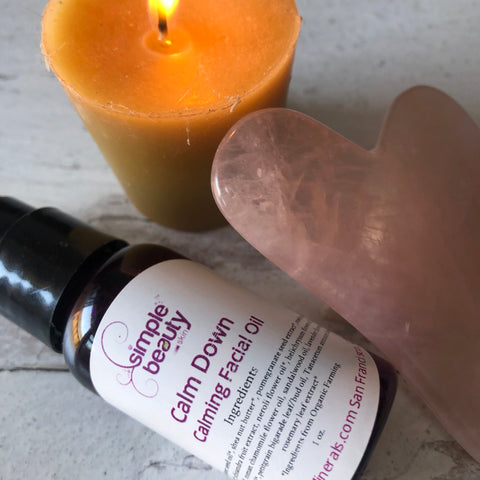 gua sha beauty stone calm down facial oil and beeswax candle