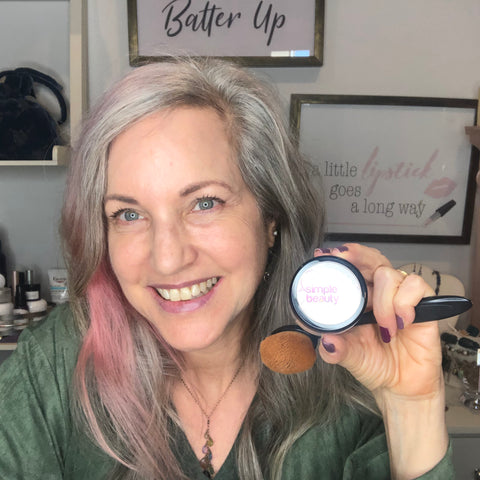 lisa with out makeup, before photo, holding a jar of sbm powder makeup