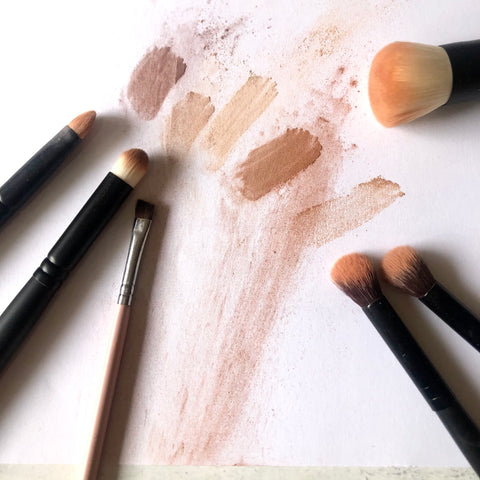 eyeshadow swatches and makeup brushes