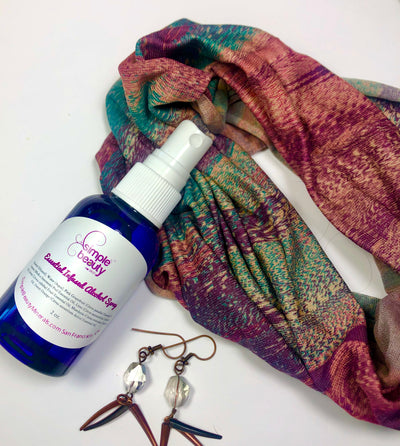 alcohol spray with scarf and earrings