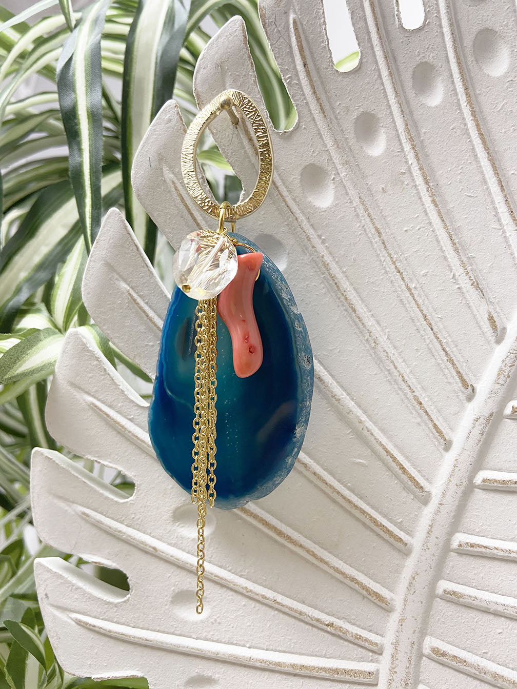 coral and dark teal agate eye catcher