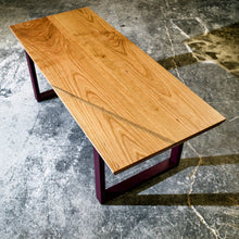 Beveled edge cherry table with walnut accent. Steel legs in Bordeaux Red
