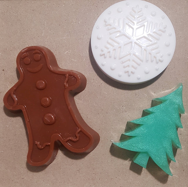 brown gingerbread man , white  snowflake and green  christmas tree natural soap collection.