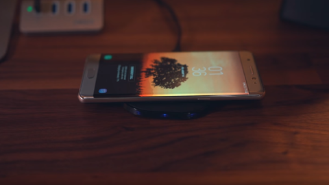 A smartphone on a wireless charging pad
