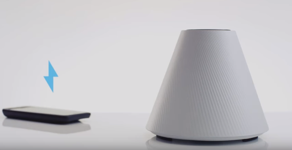 The Pi wireless charging cone next to a smartphone