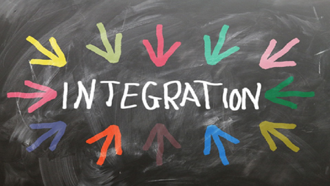 Integration written on chalk board with many different coloured arrows pointing towards it