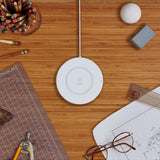The Belkin BOOST↑UP 15W Wireless Charging Pad White plan view on desk