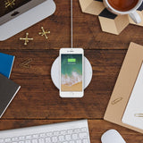 The Belkin BOOST↑UP 7.5W Wireless Charging Pad plan view with phone on on desk