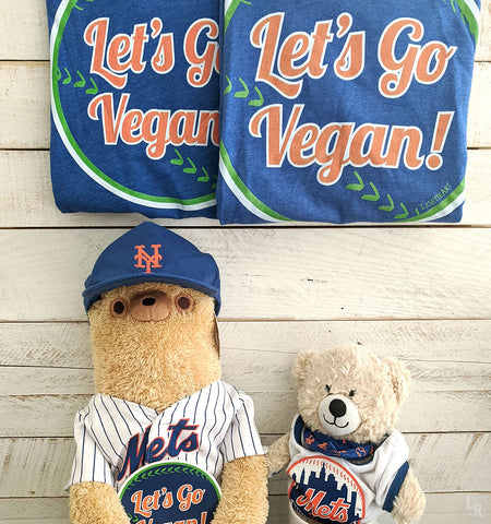 "Stuffed animals showcasing ""Let's Go Vegan"" sticker and shirts"