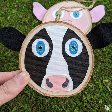 Cow with blue glitter eyes wood ornament