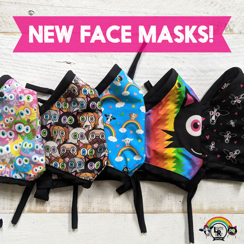 Row of folded animal themed printed face masks