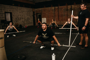 Weightlifters Practicing Snatch