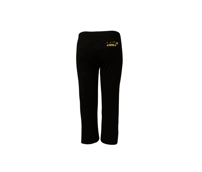 Womens capri pants in black with a scrunch bottom. Hand-screenprinted with gold Aloha Shapes ® logo on top right back