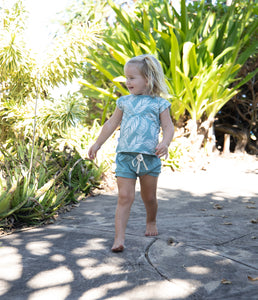 Young children playing at beach park wearing Skye HI tropical toddler clothes designed in Maui Hawaii