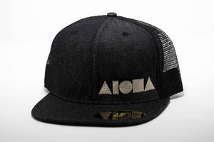 Adult flat brim snapback hat. Black denim flat brim. Black denim front panels. Black mesh back panels. White embroidered Aloha Shapes® logo.