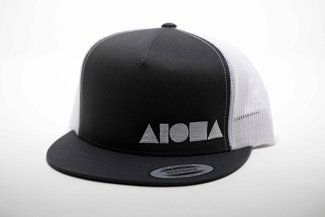 Adult flat brim snapback hat. Dark grey brim and front panel embroidered with white ALOHA Shapes ® logo. White mesh back panels.