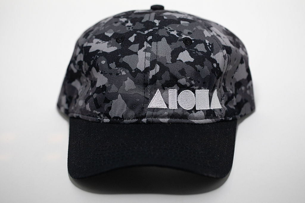 Dad hat with black brim and greyscale Hawaiian island camouflage on top