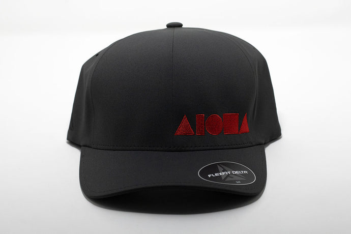 Delta Flexfit adult hat in dark grey embroidered with Aloha Shapes ® logo in red.