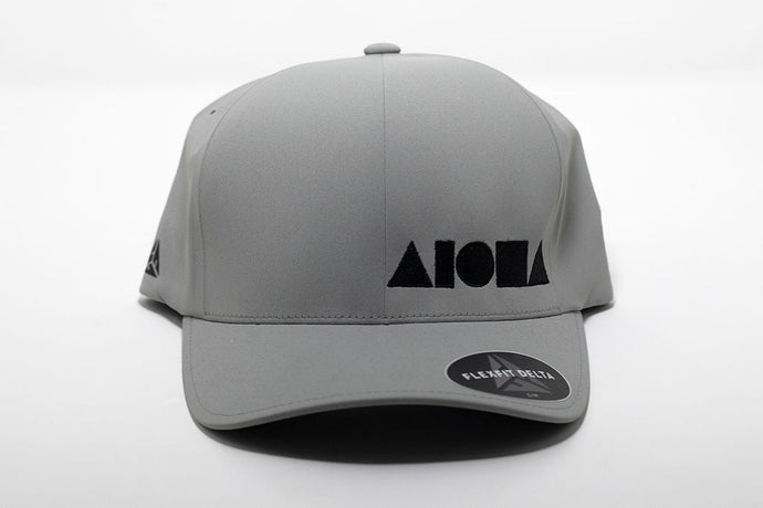 Adult Flexfit ALOHA Shapes ® logo hat. Light Grey waterproof material embroidered with black ALOHA Shapes ® logo