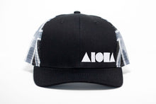 Limited edition adult curved bill snapback. Black brim and front panels. Greyscale Hawaiian flag printed on mesh back panels. Embroidered with white Aloha shapes ® logo